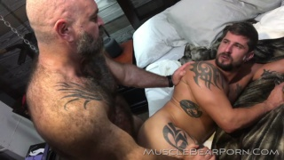 muscle bear daddy fucks his boy in a red sling