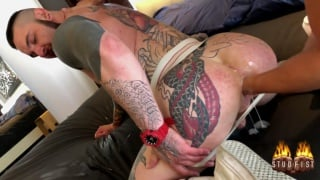heavily-inked bottom gets his big ass fisted