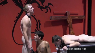 one slave boy sucks his master's dick while another watches