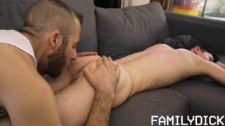 stepfather gives his stepson a special massage on the couch