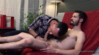 bearded stud gets a blowjob from an older man