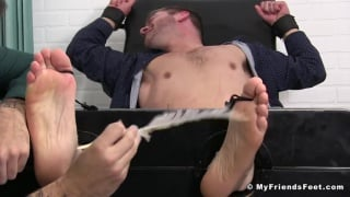 guy in executive work clothes restrained and tickled