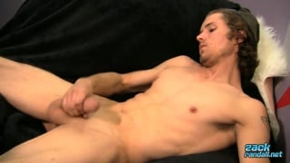scruffy guy strokes his long dick