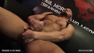bald muscle man plays with his nuts while jerking off