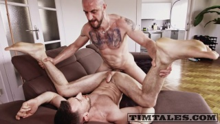 inked man spreads bottom's legs & drives his big cock home
