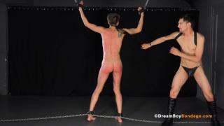 master in jockstrap & boots beats his slave's ass