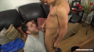 shy daddy rides his boy's cock while wearing a t-shirt
