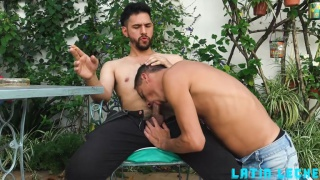 latin lad gives camera man a slobbery, deep throat blowjob