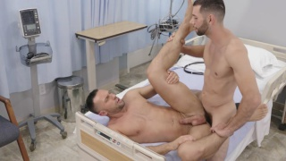 sexy janitor fucks a nurse in one of the patient rooms