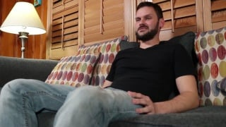 sexy bearded man gets head on the couch