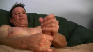 Daddy plays with his cock