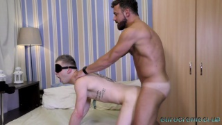 muscle hunk blindfolds his bottom and fucks him