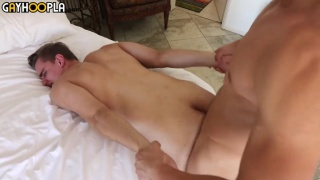 top stud holds his bottoms hands while fucking him from behind