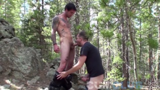 tall inked stud gets an outdoor blowjob