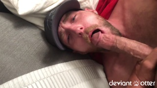 bearded cocksucker gobbling a big veiny cock
