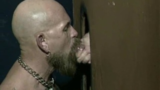 gloryhole sex with mature bearded man