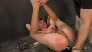 euro boy gets his legs pushed over his head for a spanking