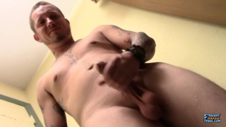 inked guy uses a masturbation sleeve on his dick