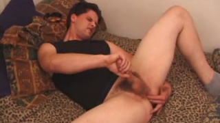 guy works his dick on the bed & standing against wall