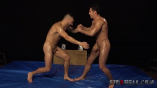 naked guys rolling over the floor in wrestling match