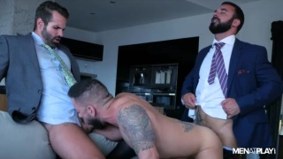 two men in suits share a hot piece of ass