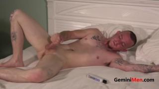 inked guy fingers his hole & jacks off