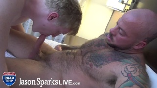 inked muscle stud gets his dick worshipped by boyish bottom