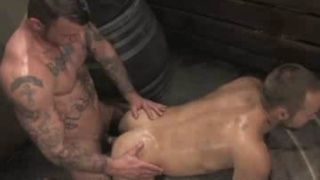 Hard tattooed dominant male fucks hairy bottom boy