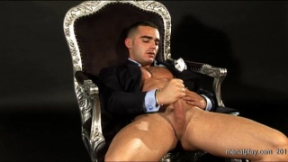 Suited hunk jerking off