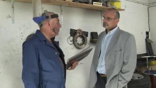 Older Man Serviced by Mechanic