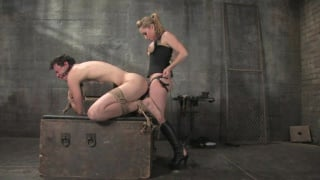 Gorgeous woman dominates submissive male slave