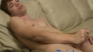 Twink beats off on the couch