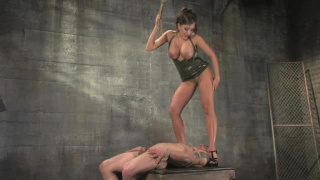 Dominant female tortures male slave
