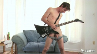 Guitar Player Sits on Dildo