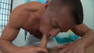 Tyler Saint Gives Service on Massage Table