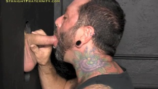Sucking Off Inked Dude at Glory Hole