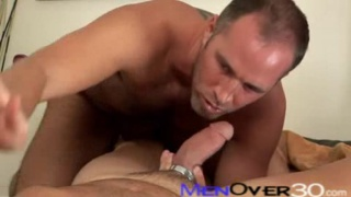 Mature guys having sex