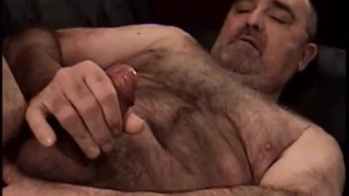 Stocky Hairy Man Playing with Cock