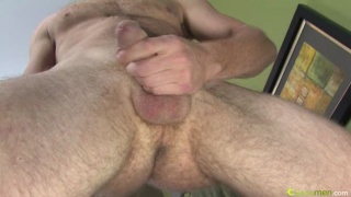 Hairy stud jerking his manmeat