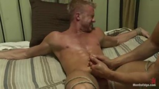 Muscle Hunk Tied to Bed and Edged