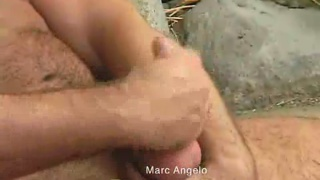 Hairy bear strokes his dick