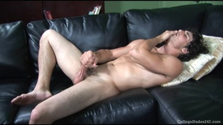 Hot buddy jerks off on the leather couch