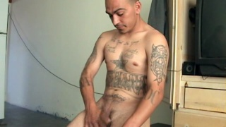 Latino with tattoos and uncut dick