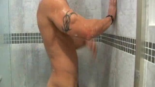 Cleancut man plays with ass and cock