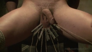 bound jock gets clothes pegs pinned to nuts
