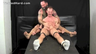 inked daddy tickles a younger stud