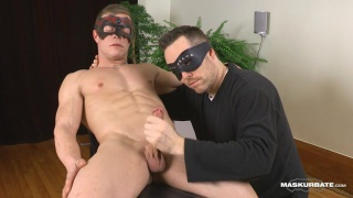 masked hunk gets his hard dick stroked
