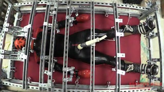 rubber sub restrained in metal cage