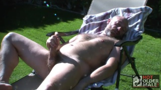 beefy daddy beating off outdoors