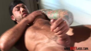 inked muscle hunk flexes and strokes his cock